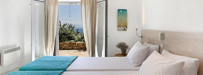 Bedroom, sea and pool view