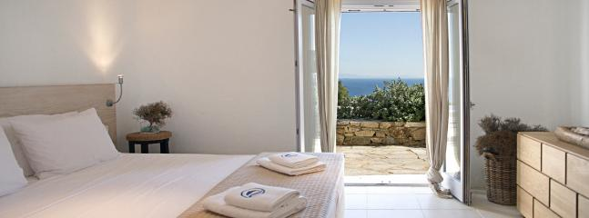 Master bedroom with en-suite bathroom, sea and pool view,
