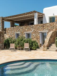 Stonewalls blended with whitewashed walls: view from the pool
