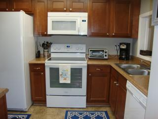 Kitchen with new appliances and cabinets.