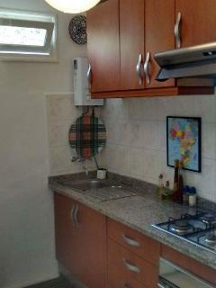 Separate modern kitchen with oven & hob