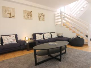Large and very comfortable living room with direct access to outside. TV, DVD player and stereo.