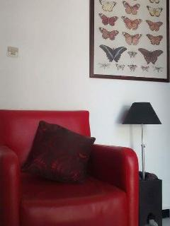 Salon has a sofa, armchair Tv and aircon