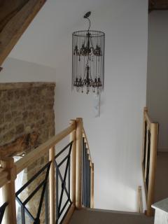 Chandelier in hallway upstairs