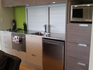 Cleverly self contained with kitchen and BBQ on deck.  Also washing machine and tumble dryer