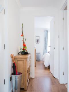 Bright hallway leading through to the master bedroom