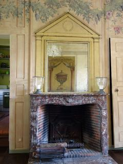 The fireplace in the salon.