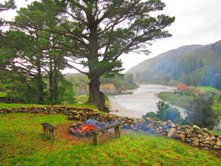 Fire pit overlooking the crystal clear Waiohine River