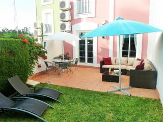 Outdoor living - rattan corner sofa, sun loungers, hot plate/BBQ and parasols for shade if required.