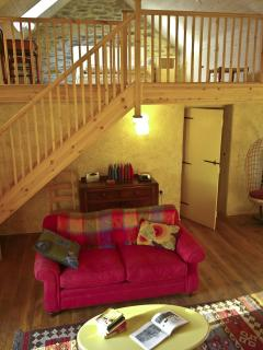 Open stairs lead from the living room to the mezzanine which is a great place for children..