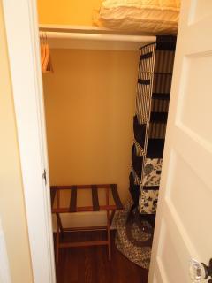Closet with Wood Hangers ; Luggage Rack