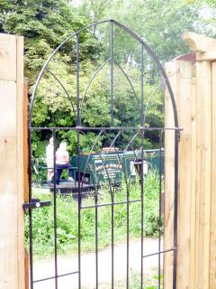 Moorhen Cottage view through back gate as boats go by