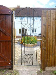 Moorhen Cottage - view from canal towpath through back gate