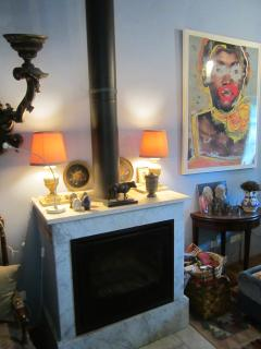 Fireplace and vignette of objects on the firebox...