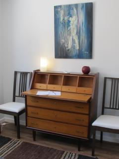 commode with a desk at the top