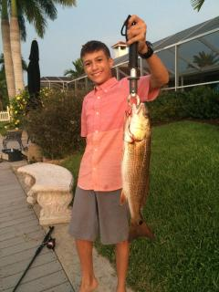 A young guest with  9 lb Redfish, 8/12/2015, We can also arrange for boat rental or fishing charter.