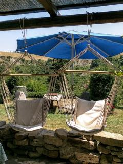 Enjoy our hammocks , umbrella and lounge chairs