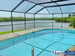 Waterfront house on key lot w/ large heated pool and view of Marco River, Marco Island