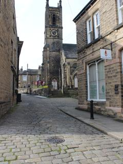 The church and cobbled streets of the local village, Honley. Good restaurants, pubs and shops.