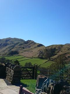 A view of one of the great nearby Lake District Fell ridge walks from the terrace at Hause Hall Farm