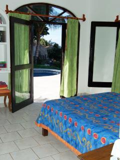 View of pool terrace from queen bedroom