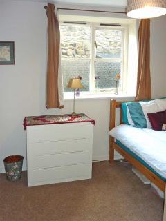 Single bed in downstairs bedroom