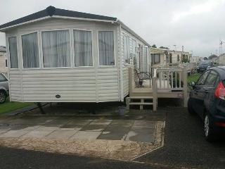 Front view of the caravan and two hard-standing carparking spaces.