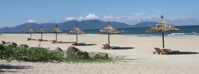 The beach is just a short walk within the green resort.