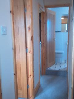 Door to bedroom 5 & bedroom 6 with ensuite at end of corridor