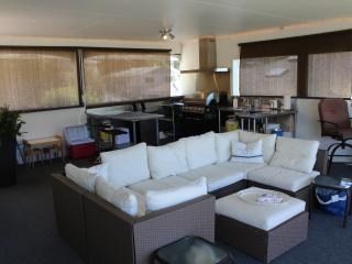 400 sq. ft of outdoor living space with big beautiful views. BBQ / kitchen space at the back.