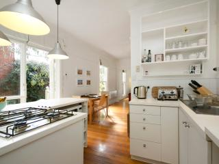 Fully equiped kitchen and breakfast bar with great garden views