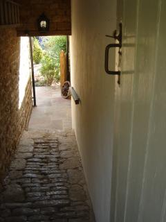 Cobbled passageway to pretty garden...