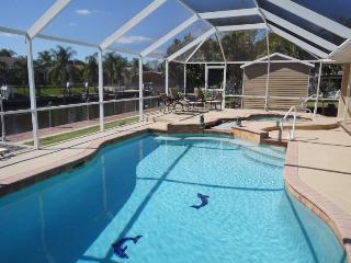 Serenity - Cape Coral 3b/2ba home w/electric heated pool/spa, gulf access canal, HSW Internet, Boat Dock and Lift