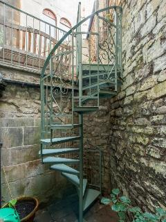 Spiral staircase leading up to the patio (children must be supervised in this area)