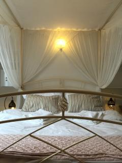 romantic King size 4 poster bed with cushions, throw and drapes for extra privacy