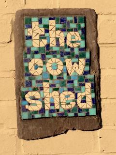 the cow shed handmade mosaic sign