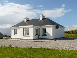 TEACH SHEONAI, detached, ground floor cottage, en-suite, open fire, sea views, i