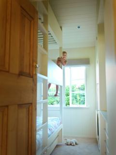 the custom built 3-tier bunk room is popular with kids