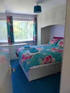 Double Bedroom with fitted wardrobe. Views over looking south facing garden