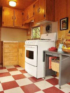 Kitchen in vintage trailer.