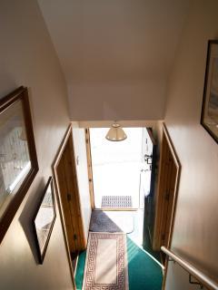 View - looking down stairs to front door (half/stable door)