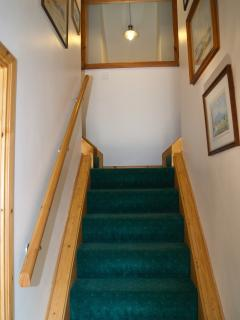 Upstairs and turn left for 2 single beds or right for 1 single bed and upstairs WC and shower room.