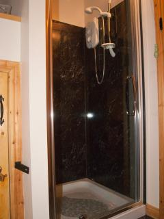 Large electric shower in upstairs room with WC.