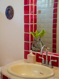 Fiery red tile in a beautiful bathroom