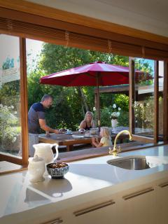 bi-fold windows conveniently open up to the outdoor dining