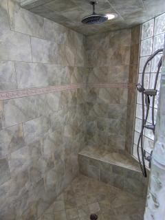 Rain shower head in master bath shower.