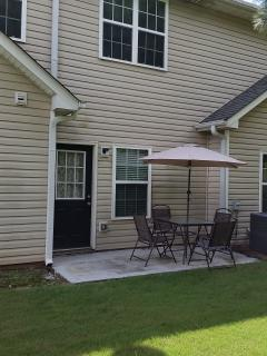 Patio Area with outdoor table, chairs, and umbrella
