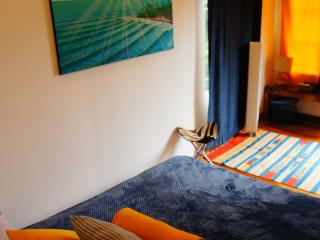 The Master Suite, outfitted with Queen Bed, Egyptian cotton sheets, local art and air-conditioning