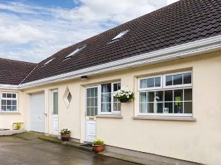 RING FORT COTTAGE, pet-friendly, open plan living, en-suite bedroom, close to