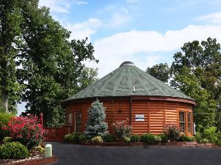 Caleb's Hideaway a round shaped two bedroom cabin with a kids play area., Sevierville